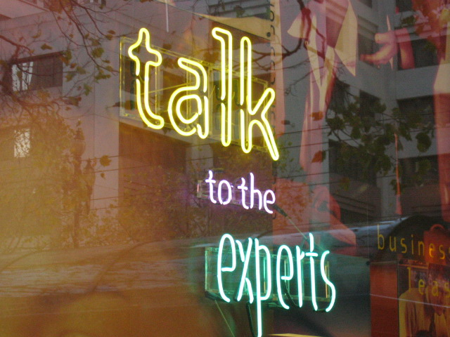 "Neonlights saying: ""Talk to the Experts"""