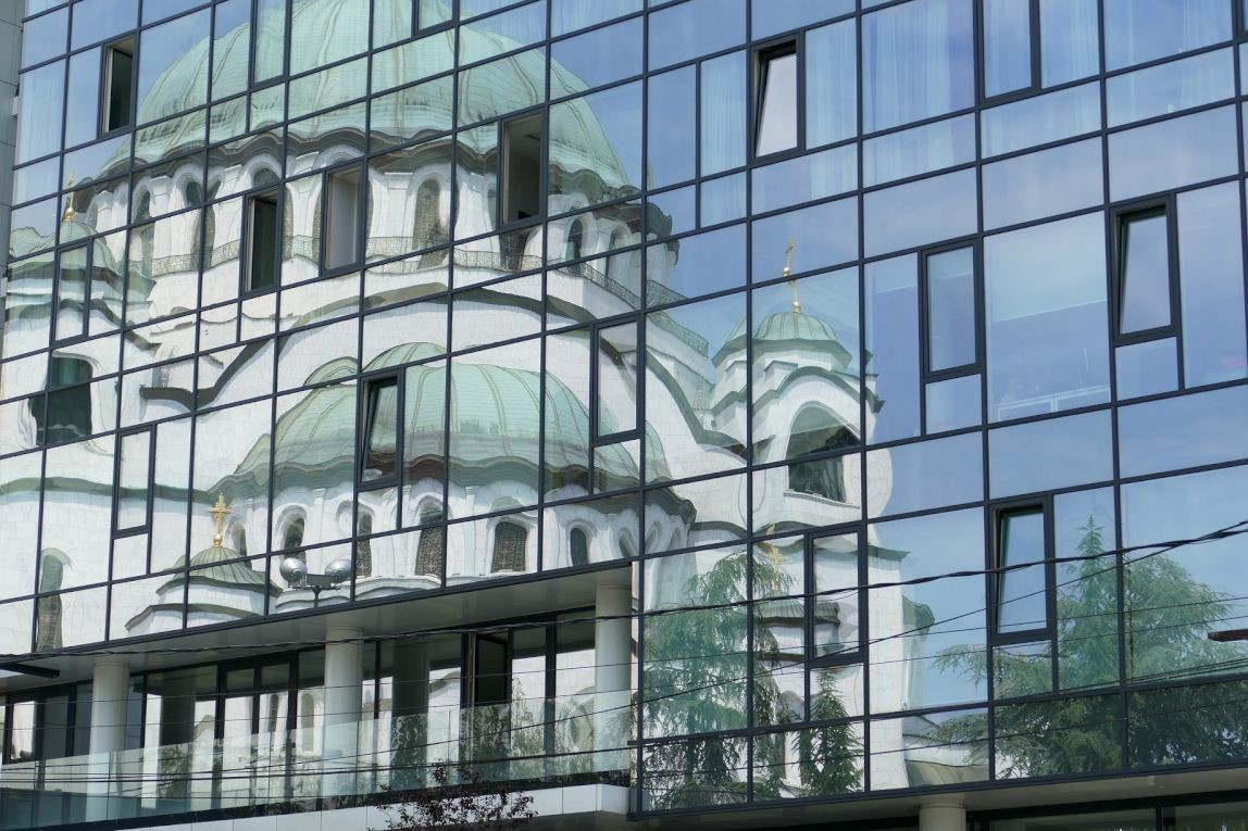 Monument in city of Belgrade through reflection