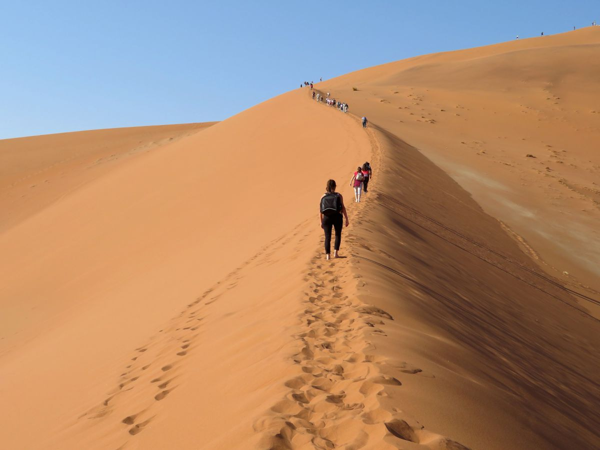 People walking through the dessert