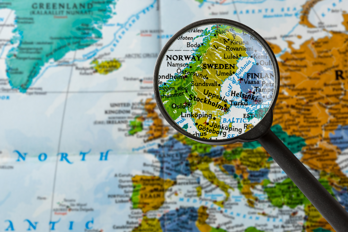 Magnifying glass on a map points to the Nordic countries